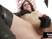 Latex ladyboy toying her bum with big buttplug