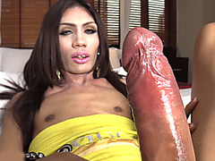 Asian ladyboy with a big dick gets her ass toyed and fucked