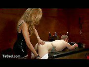 Bondage guy gets spanked and made to suck feet of blonde tranny