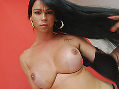 Stunning shemale shows off her big tits and bubble butt