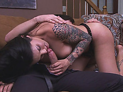 Busty tattooed shemale Ts Foxxy gets her asshole screwed