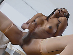 Black shemale with huge boobs solo masturbation on the bed