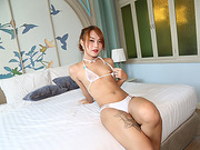 Thai trans Namlyn bares her exotic body while fapping her dick