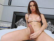 Huge boobs brunette tranny strokes her big cock on the bed